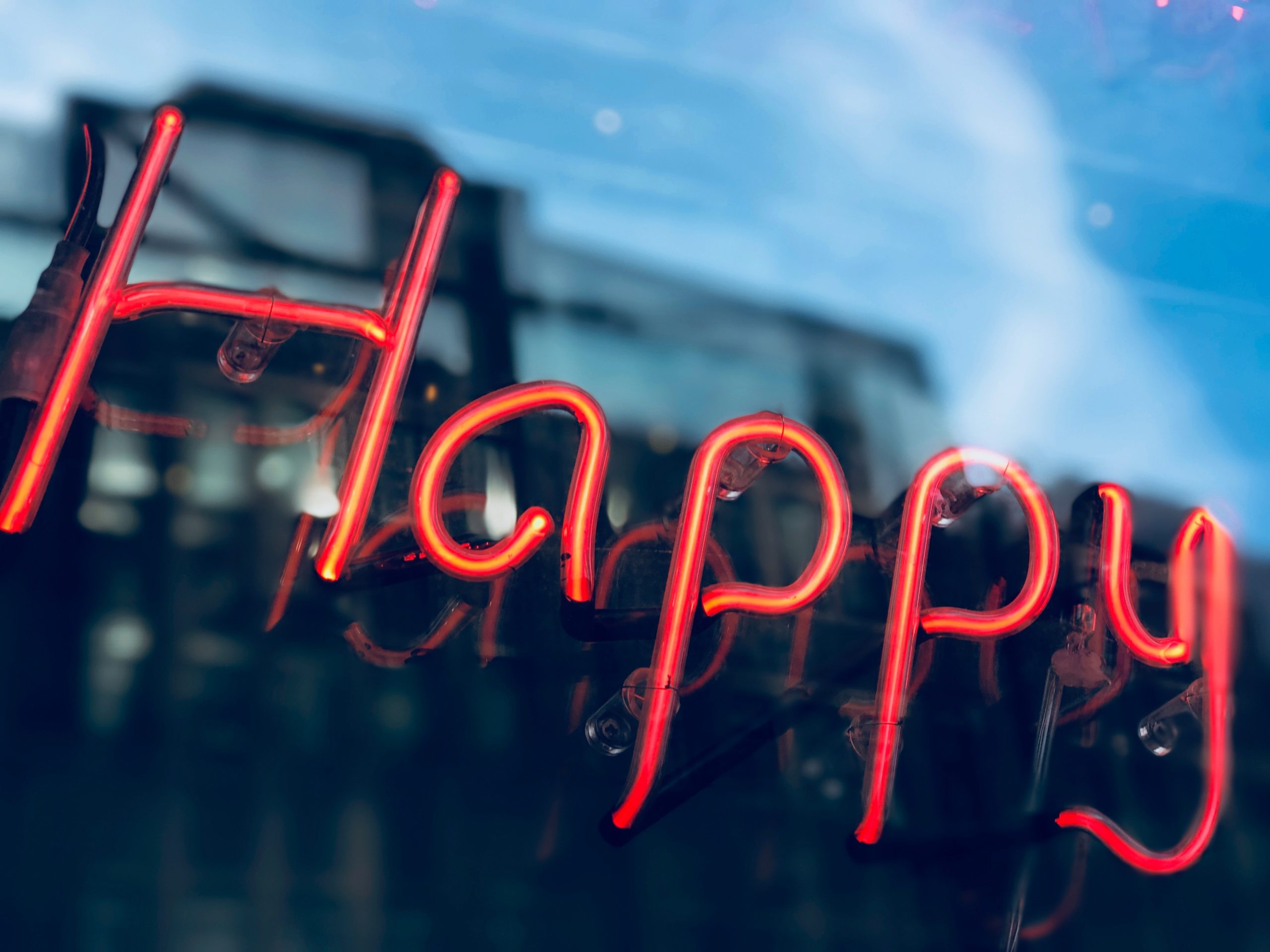 A red neon sign says Happy